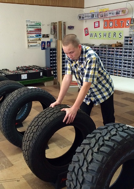Trevor working with tires